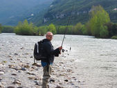 Fisherman on river — Stock Photo