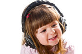 Beautiful cute happy little girl with headphones  — Stock Photo