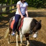 Teenage girl on horseback wearing helmet — Stock Photo #45848997