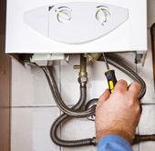 Plumber at work. Servicing gas boiler  — Stock Photo