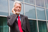Successful businessman is speaking on his smartphone — Stock Photo
