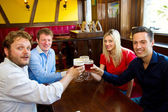 People toasting with a delicious Pale Ale Beer — Stock Photo