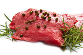 A red meat with sage and rosemary isolated on white background  — Stock Photo