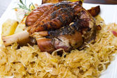Pork knuckle baked with  sauerkraut  — Stock Photo
