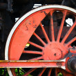 Fragment of old locomotive's wheel — Stock Photo