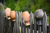Old pot on the fence — Stock Photo