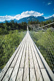 Hanging bridge over seasonal river — Stock Photo