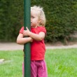 Little girl playing peek-a-boo Little girl playing peek-a-boo Little girl p — Stockfoto