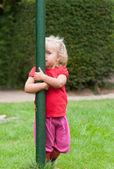 Little girl playing peek-a-boo Little girl playing peek-a-boo Little girl p — Stock Photo