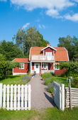 Red painted Swedish house — Stock Photo