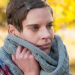 Pensive woman in warm winter scarf Pensive woman in warm winter scarf — Stock Photo