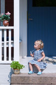 Beautiful little girl sitting on a step Beautiful little girl siiting on a step — Stock Photo