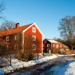 Traditional Swedish houses in winter snow — Stock Photo