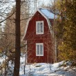 Red painted wooden house in Sweden - Stock Photo