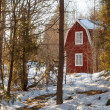 Red painted wooden house in Sweden — Stock Photo #18410099