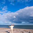 Flying a kite on the beach — Stock Photo