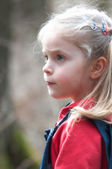 Portrait of cute little girl with long blonde hair — Stock Photo
