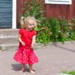 Cute little girl in red summer dress — Stock Photo