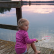 Cute little girl fishing — Stock Photo