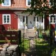Old red painted wooden house in Sweden — Stock Photo