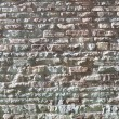 Historic wall of limestone - usable as texture or background — Stock Photo #33812437