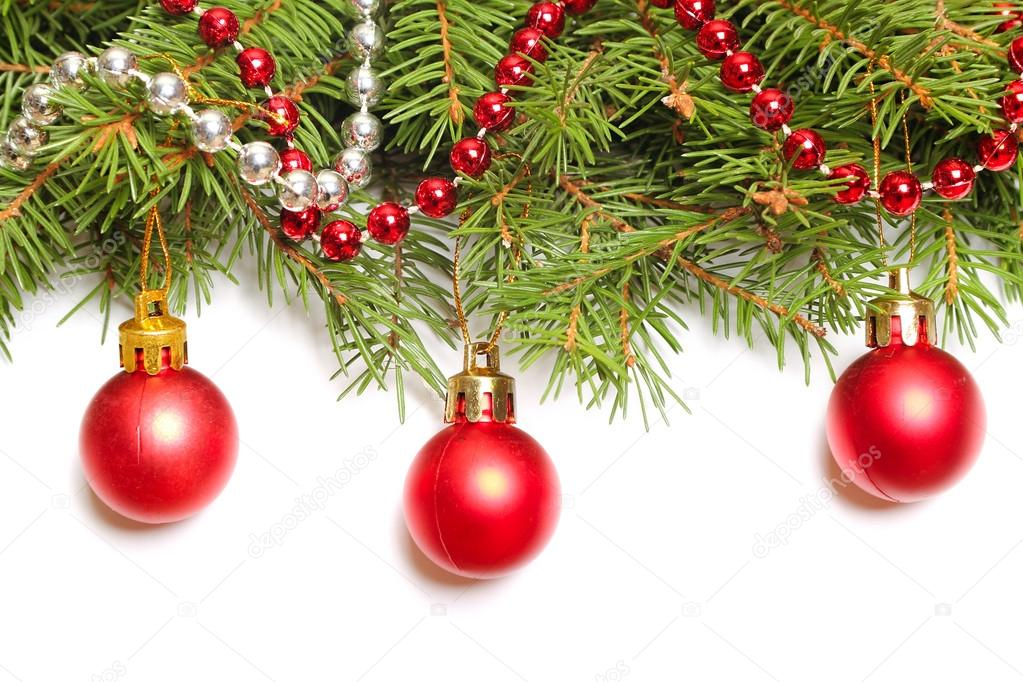 Fresh fir branch with red christmas baubles — Stock Photo #14935063