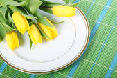 Tulips on placemats — Stock Photo
