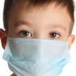 Boy in medicine mask — Stock Photo #23754575