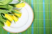 Tulips on plate — Stock Photo
