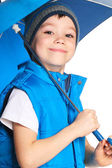 Boy with umbrella — Stockfoto