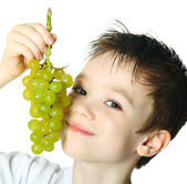 Boy with grapes — Stock Photo