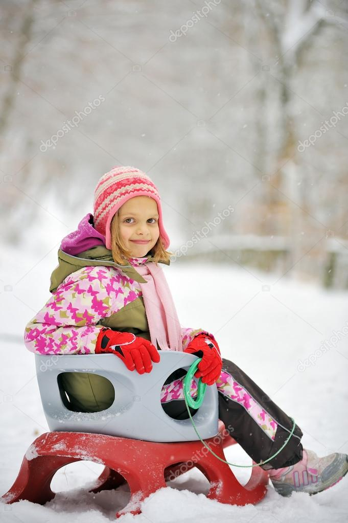 Girl on sleigh  — Stock Photo #12427139