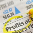 Drawing profits on financial  newspaper — Stock Photo