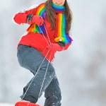 Girl sliding in the snow — Stock Photo