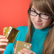 Happy girl with a gift — Stock Photo