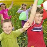 Playfulness kids on field — Stock Photo #2024209
