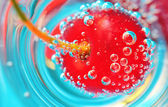 Cherry and bubbles — Stock Photo