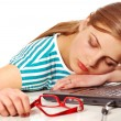 Girl sleeping on her laptop — Stock Photo