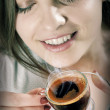Beautiful girl drinks coffee — Foto de Stock