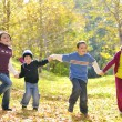 Happy kids and autumn leaves — Stock Photo