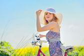 Woman on a bicycle — Stock Photo