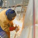 Worker grinding metal — Stock Photo