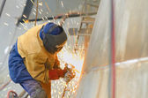 Worker grinding metal — Stock Photo