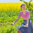 Royalty-Free Stock Photo: Girl on bike in spring time