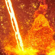 Molten hot steel pouring — Stock Photo