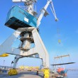 Crane and steel plate in harbor — Stock Photo