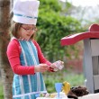 Little girl playing cooking — Stock Photo