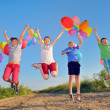 Stock Photo: Kids playing with balloons