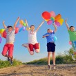 Kids playing with balloons — Stock Photo #27616555