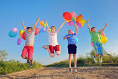 Kids playing with balloons — Stock Photo
